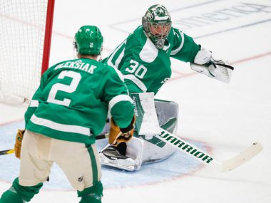 The St. Louis Blues score past Dallas Stars goaltender Ben Bishop (30) and defenseman Jamie Oleksiak (2) during the second period of an NHL matchup between the Dallas Stars and the St. Louis Blues on Friday, Feb. 21, 2020 at American Airlines Center in Dallas.