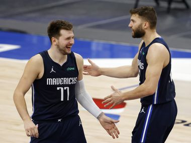 Dallas Mavericks guard Luka Doncic (77) celebrates with Dallas Mavericks forward Maxi Kleber (42) after he made a 3-pointer with less than a minute to go during the fourth quarter of play at American Airlines Center on Saturday, February 6, 2021 in Dallas. Dallas Mavericks defeated the Golden State Warriors 134-132.