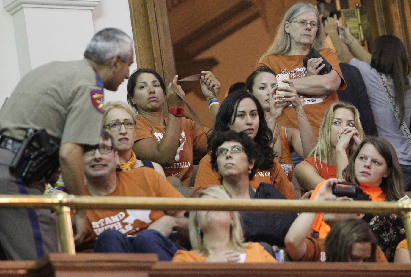 DPS officers clear out rowdy gallery members as they react after a third point of order halts her filibuster during the final day of the legislative special session, as the Senate considers an abortion bill on Tuesday, June 25, 2013.  (Louis DeLuca/Dallas Morning News) 06302013xBIZ