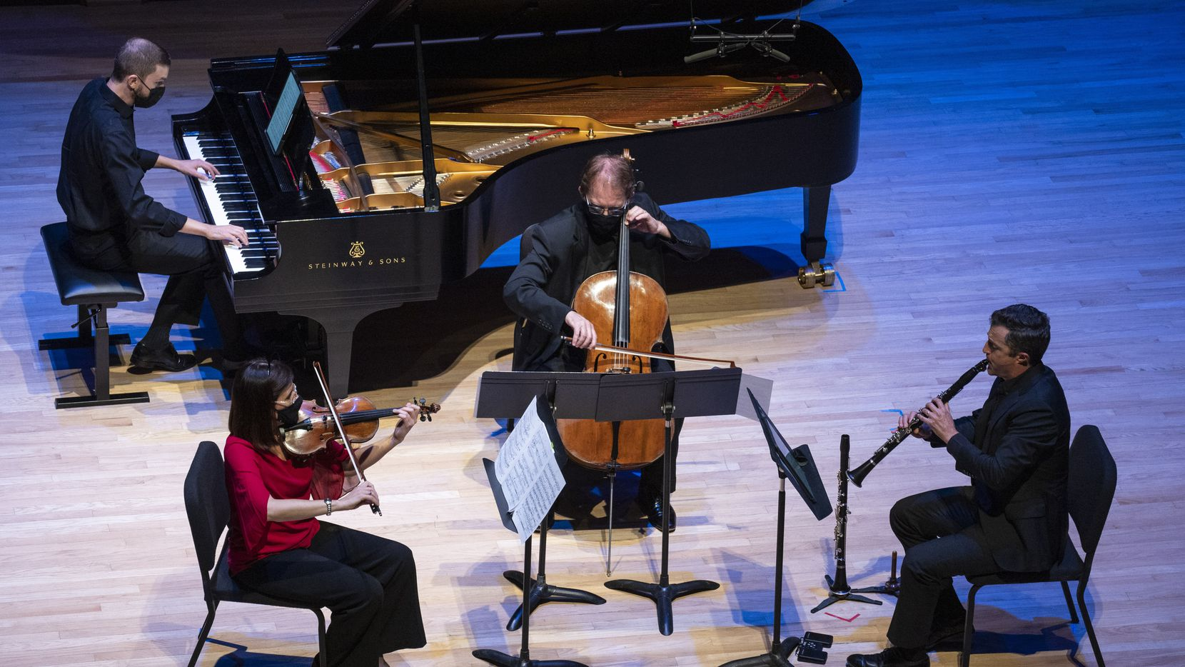 Evan Mitchell, piano, Maria Schleuning, violin, Jolyon Pegis, cello, and Stephen Ahearn, clarinet, perform 'Swallowing Fire' (2020-21) by American composer Peter Askim during Voices of Change's season opening concert on Sept. 19 at Southern Methodist University's Caruth Auditorium in Dallas.