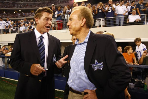 Troy Aikman (left) and Roger Staubach chat before the halftime ceremonies of the Cowboys-Giants game at Cowboys Stadium in Arlington on Sept. 20, 2009. The game was the first regular season game played at the stadium.