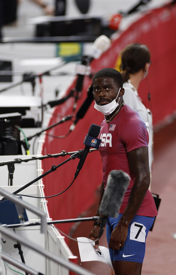 USA's Trayvon Bromell watches the replay of his race before answering questions from the media after competing in the 100 meter qualifying race during the postponed 2020 Tokyo Olympics at Olympic Stadium, on Saturday, July 31, 2021, in Tokyo, Japan. Bromell finished fourth with a time of 10.04. (Vernon Bryant/The Dallas Morning News)