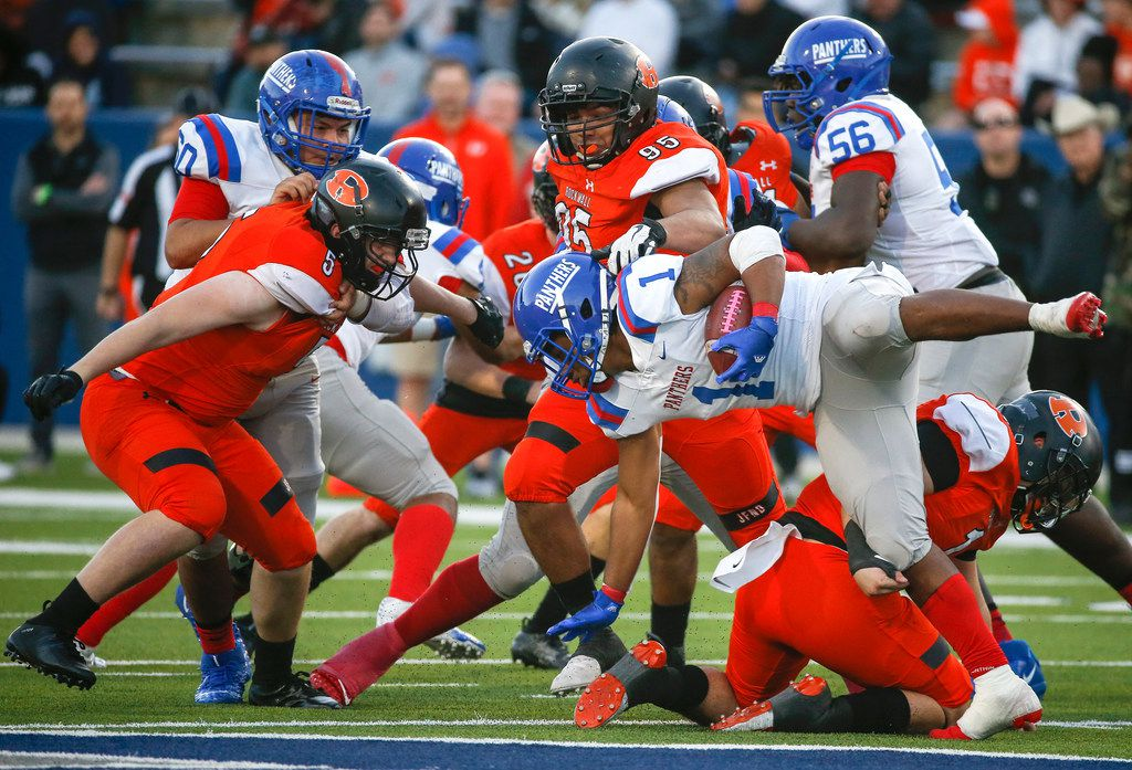 Duncanville running back Trysten Smith (1) is brought down by Rockwall to end a run during the second half of a Class 6A Division I state semifinal football matchup between Rockwall and Duncanville on Saturday, Dec. 14, 2019 at McKinney ISD Stadium in McKinney, Texas. (Ryan Michalesko/The Dallas Morning News)