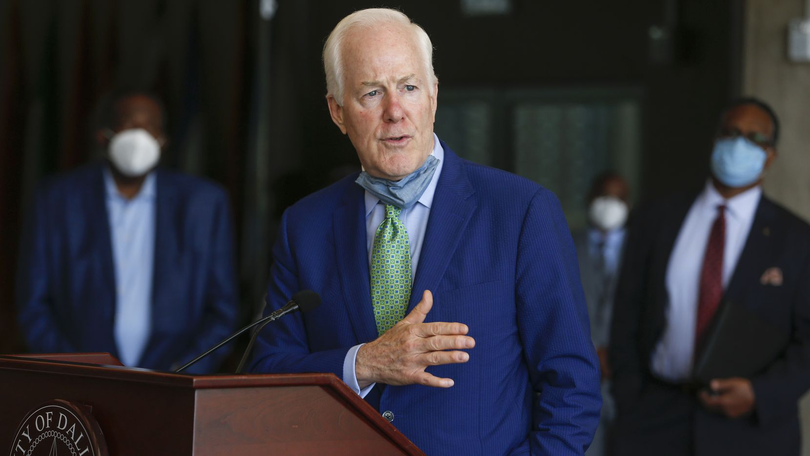 U.S. Senator John Cornyn, R-Texas, addresses members of the media following a law enforcement roundtable in June at City Hall in Dallas.