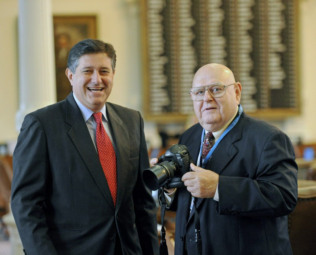 Rep. Richard Raymond (left) is shown with former Associated Press photographer Harry Cabluck, who was honored in 2011. Raymond, a Laredo Democrat, says he will file legislation to clarify that daily fantasy sports games, like those sponsored by DraftKings and FanDuel, are not gambling and legal in Texas. (File Photo/The Associated Press)