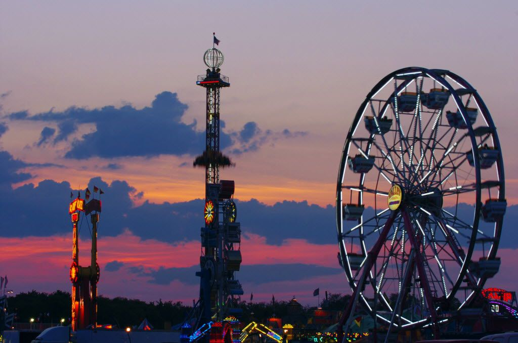 The sun sets over the North Texas Fair and Rodeo Saturday night, Saturday, August 24, 2013, in Denton, TX. David Minton/DRC