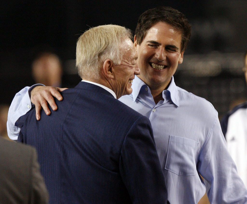 Dallas Cowboys owner Jerry Jones and Dallas Mavericks owner Mark Cuban share a hug after announcing the attendance during the NBA All-Star game at Cowboys Stadium in Arlington, Texas, on Feb. 14, 2010.  (Vernon Bryant/The Dallas Morning News) 02152010xSPORTS