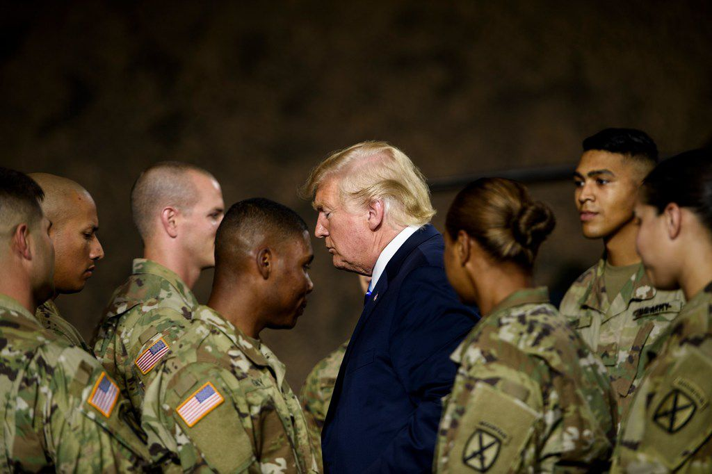 President Donald Trump leaves after signing the John S. McCain National Defense Authorization Act for Fiscal Year 2019 at Fort Drum, N.Y., on Aug. 13. A military parade ordered by Trump for later this year has been postponed until at least 2019, a defense official said.