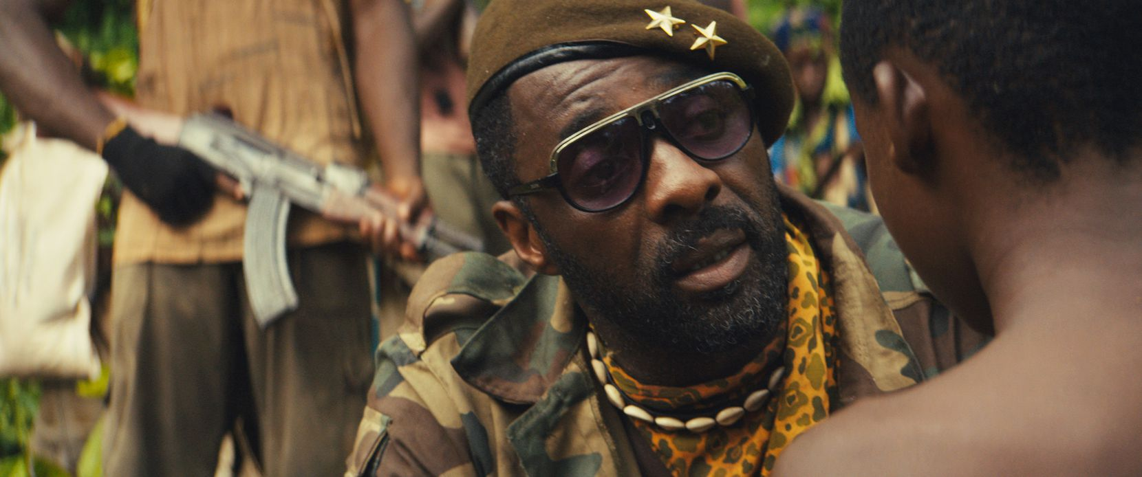 """Idris Elba, center, as Commandant, in the Netflix original film, """"Beasts of No Nation,"""" directed by Cary Fukunaga."""