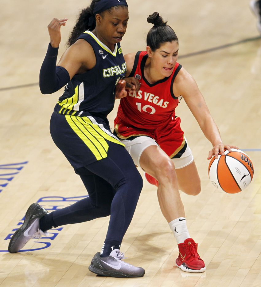 Las Vegas guard Kelsey Plum (10) attempts to dribble around the defense of Dallas guard Arike Ogunbowale (24) during second half action. The two WNBA teams played their game at College Park Center on the campus of UT-Arlington on July 11, 2021. (Steve Hamm/ Special Contributor)