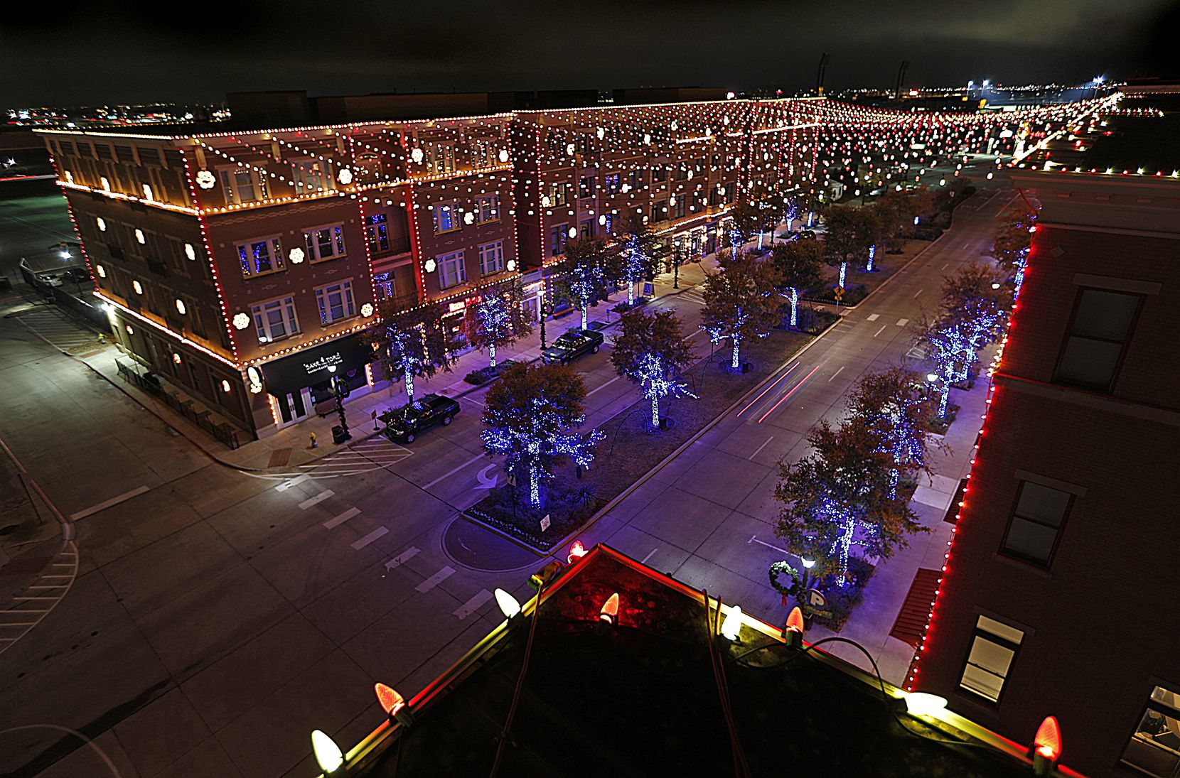 Jeff Trykoski is the mastermind behind the annual holiday light show at Frisco Square which is synchronized to music. He tested the system on Monday night, Nov. 25, 2013.