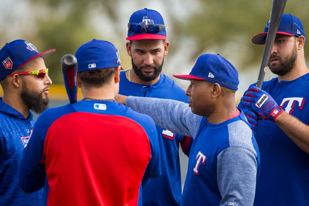 Texas Rangers third base coach Tony Beasley (second from right) works with (from left) Rougned Odor, Shin-Soo Choo, Nomar Mazara and Joey Gallo during a spring training workout at the team's training facility on Friday, Feb. 23, 2018, in Surprise, Ariz. (Smiley N. Pool/The Dallas Morning News)