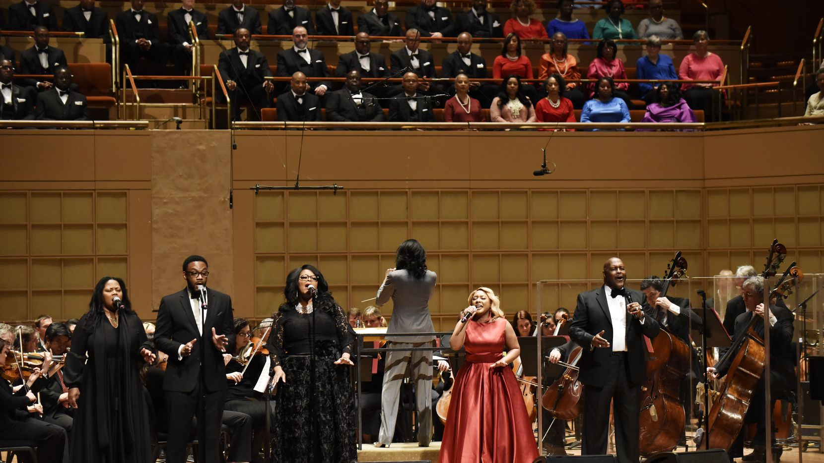 Singer DeShonda Rideout, right, and Bishop Marvin Winans, far-right, sing with the Dallas Symphony Orchestra during a performance of Gospel Goes Classical, Feb. 7, 2019 at the Morton H. Meyerson Symphony Center in Downtown Dallas.