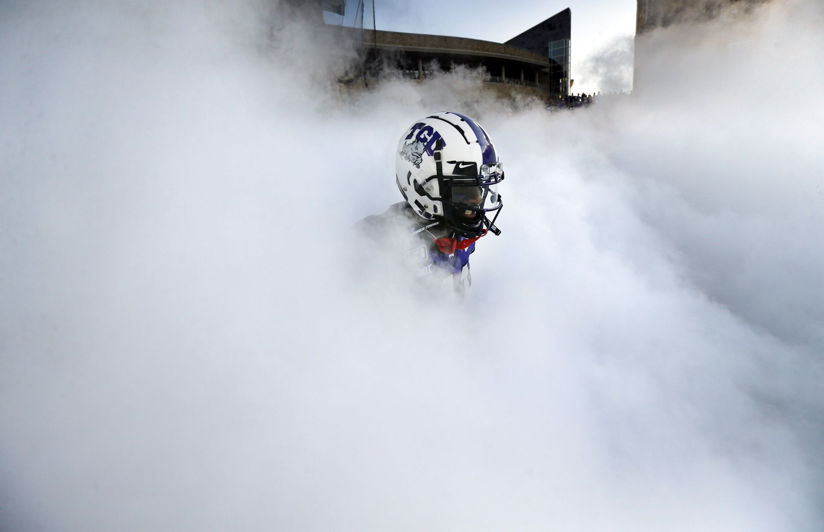 TCU Horned Frogs </bold>wide receiver Dylan Thomas appears in the fog as the team is introduced before its game against the Arkansas-Pine Bluff Golden Lions at Amon G. Carter Stadium in Fort Worth.