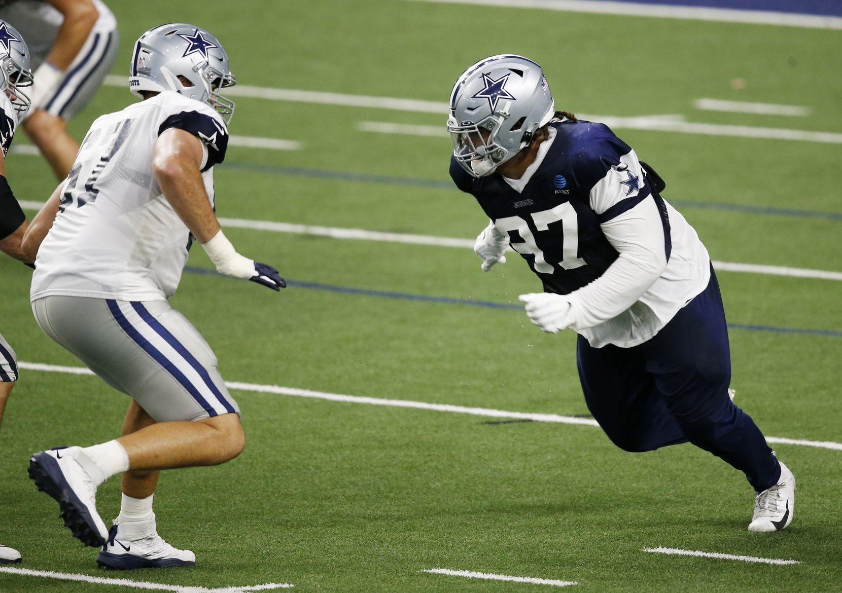 Dallas Cowboys defensive tackle Trysten Hill (97) attempts to pass Dallas Cowboys offensive tackle Wyatt Miller (67) after the snap during training camp inside the Ford Center at the Dallas Cowboys headquarters at The Star in Frisco, Texas on Tuesday, August 18, 2020. (Vernon Bryant/The Dallas Morning News)