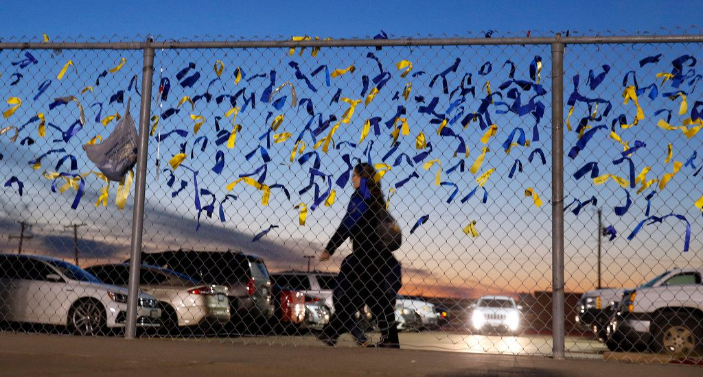 In the wake of four Nevada Community student deaths earlier this week, condolence ribbons were tied to the fence at Community ISD Stadium in Nevada, Texas, Friday, November 8, 2019. The four high school students were killed earlier this week in a tragic vehicle accident. (Tom Fox/The Dallas Morning News)