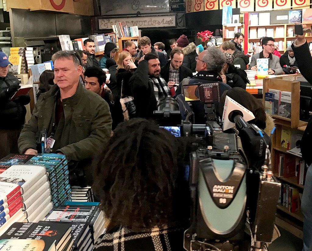 Customers line up at Kramerbooks late Thursday for the midnight sale of Michael Wolff's Trump White House book, Fire and Fury. Journalists also turned out in large numbers. Among its anecdotes is that even Trump's most loyal advisers grew to grimace when they saw Kellyanne Conway's increasingly outrageous defenders of the President.
