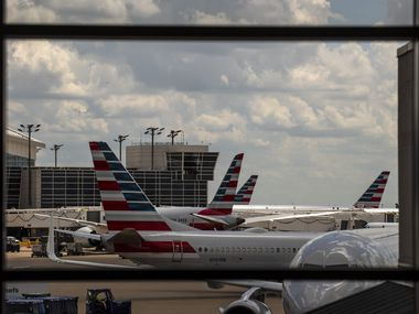 Planes from American Airlines outside of Terminal B at DFW International Airport, on Thursday, July 23, 2020.