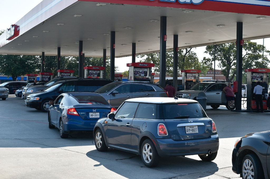 Locals wait in line to fill up their vehicles with gas at a RaceTrac near South Loop 288 and Brinker Road.  Hurricane Harvey has disrupted gasoline production at refineries on the Texas Gulf Coast. As a result, consumers in Denton County are worrying about whether they'll be able to fill their tanks during the approaching Labor Day weekend., Thursday, August 31, 2017, in Denton, Texas, Jeff Woo/DRC