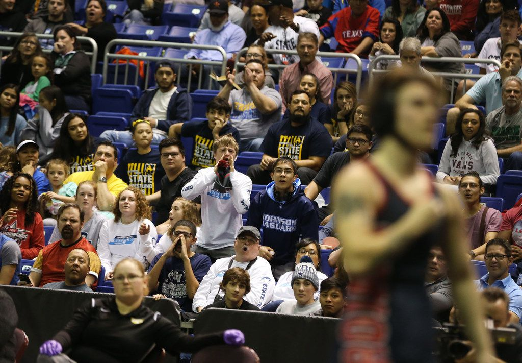 The crowd boos as Euless Trinity's Mack Beggs, a transgender male, wins the state title against Katy Morton Ranch's Chelsea Sanchez in a class 6A 110-pound bout during the girls final round of the UIL Wrestling State Championship tournament at the Berry Center in Cypress, Texas on Saturday, Feb. 24, 2018. (Rose Baca/The Dallas Morning News)