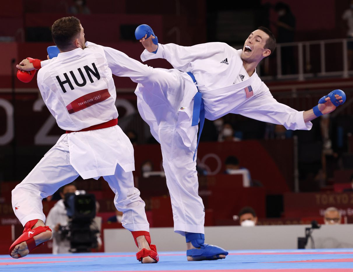 USA's Tom Scott competes against Hungary's Karoly Gabor Harspataki during the karate men's kumite -75kg elimination round at the postponed 2020 Tokyo Olympics at Nippon Budokan, on Friday, August 6, 2021, in Tokyo, Japan. Scott defeated Harspataki 8-3. Scott finished in fourth place in his pool and did not advance to the next round. (Vernon Bryant/The Dallas Morning News)