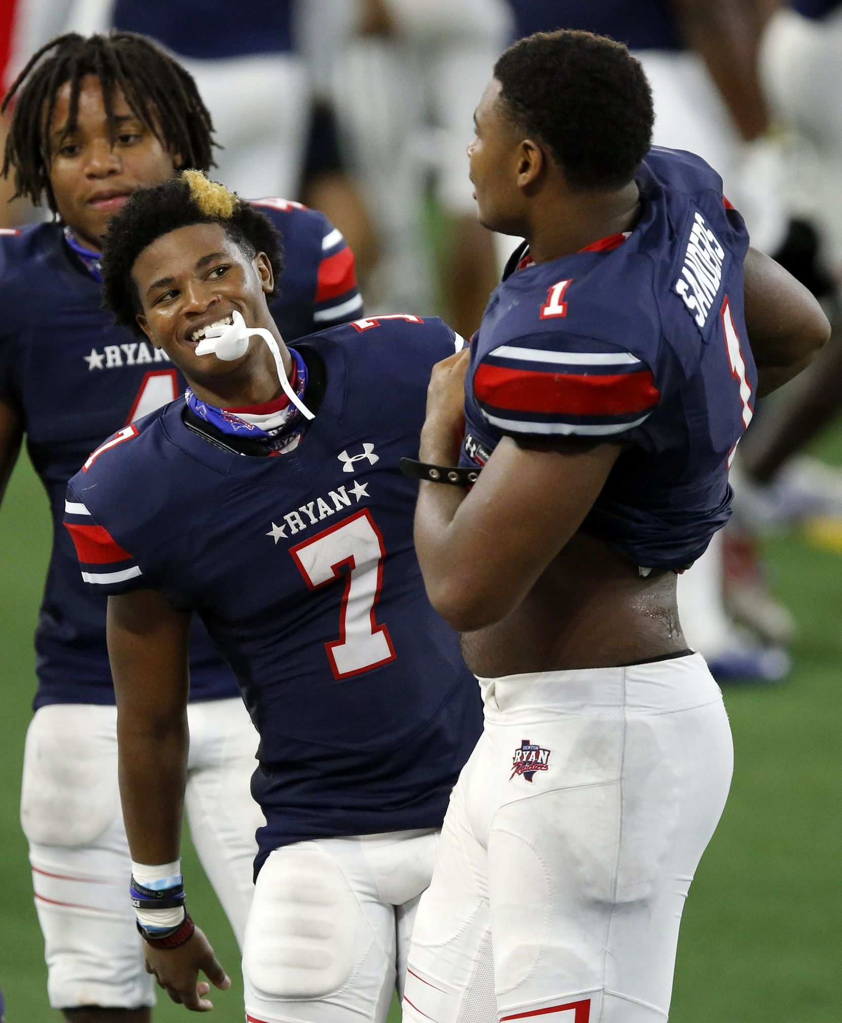 Denton Ryan cornerback Garyreon Robinson (7) jokes with receiver Ja'Tavion Sanders (1) as the two sat out the rest of the game against Arlington Martin at AT&T Stadium in Arlington, Friday, September 25, 2020. (Tom Fox/The Dallas Morning News)