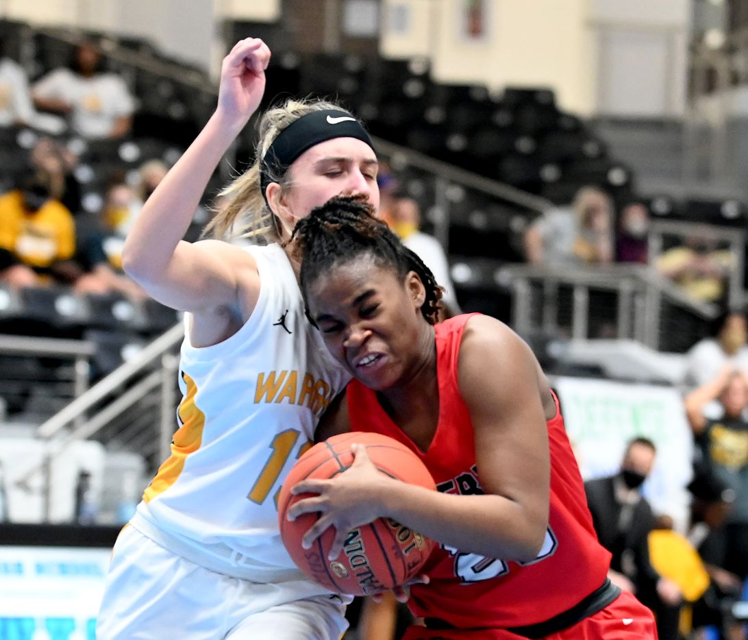 Liberty's Journee Chambers (23) drives on Memorial's Angelica Alexander in the second half of a Class 5A girls high school playoff basketball game between Frisco Memorial and Frisco Liberty, Wednesday, Feb. 24, 2021, in Frisco, Texas. (Matt Strasen/Special Contributor)