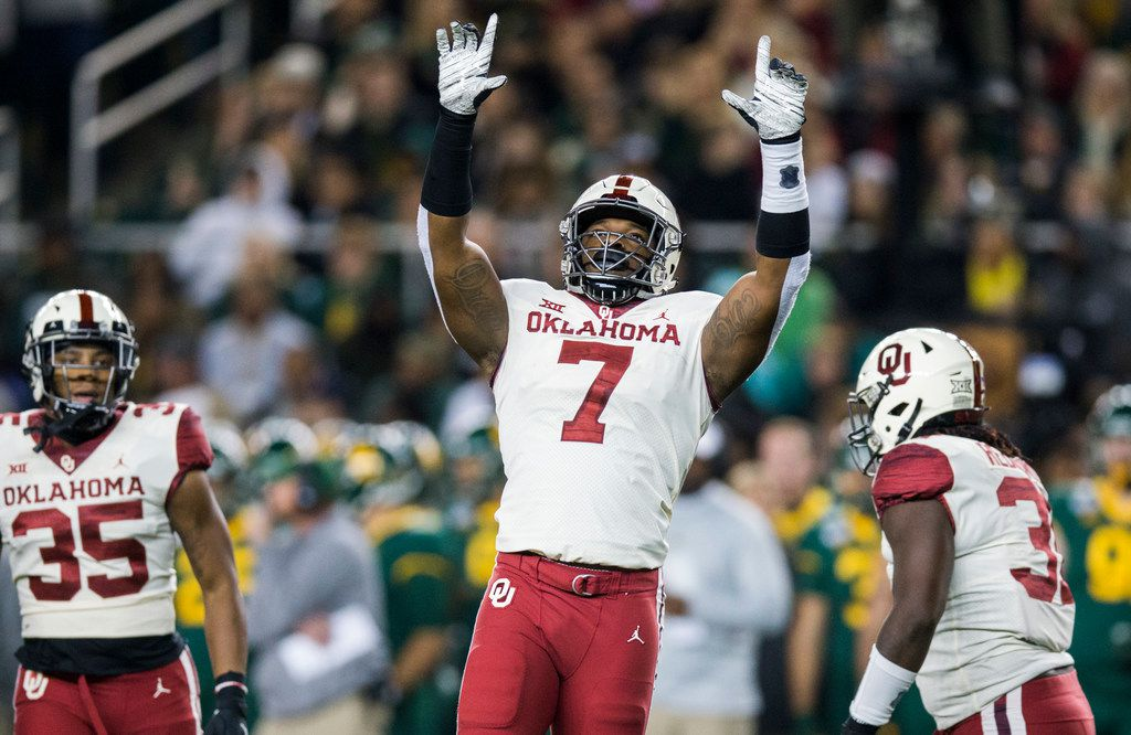 Oklahoma defensive lineman Ronnie Perkins (7) celebrates a sack in the first quarter of a game against Baylor on Saturday, Nov. 16, 2019, at McLane Stadium in Waco.