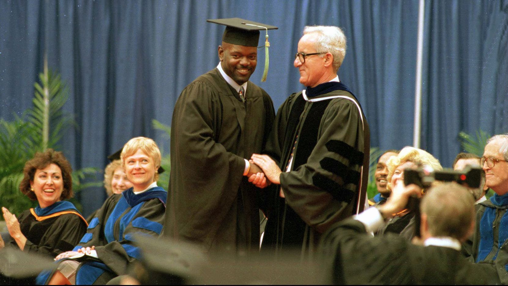 Cowboys running back Emmitt Smith is congratulated by University  of Florida President John Lombardi during one of two commencement  ceremonies on the Gainesville campus Saturday, May 4, 1996. Smith,  who received a bachelor of science in recreation, left college for the National Football League before his senior season in 1990  but vowed to his family he would return and earn his degree. (AP  Photo/University of Florida, Jeff Gage, HO)