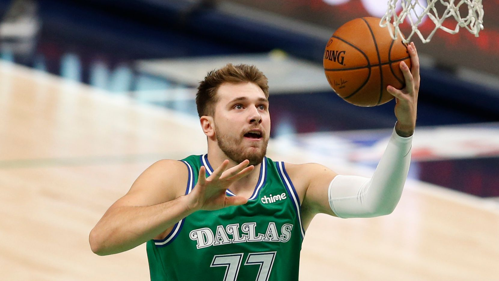 Dallas Mavericks guard Luka Doncic (77) attempts a layup in a game against the Charlotte Hornets during the first quarter of play in the home opener at American Airlines Center on Wednesday, December 30, 2020 in Dallas.