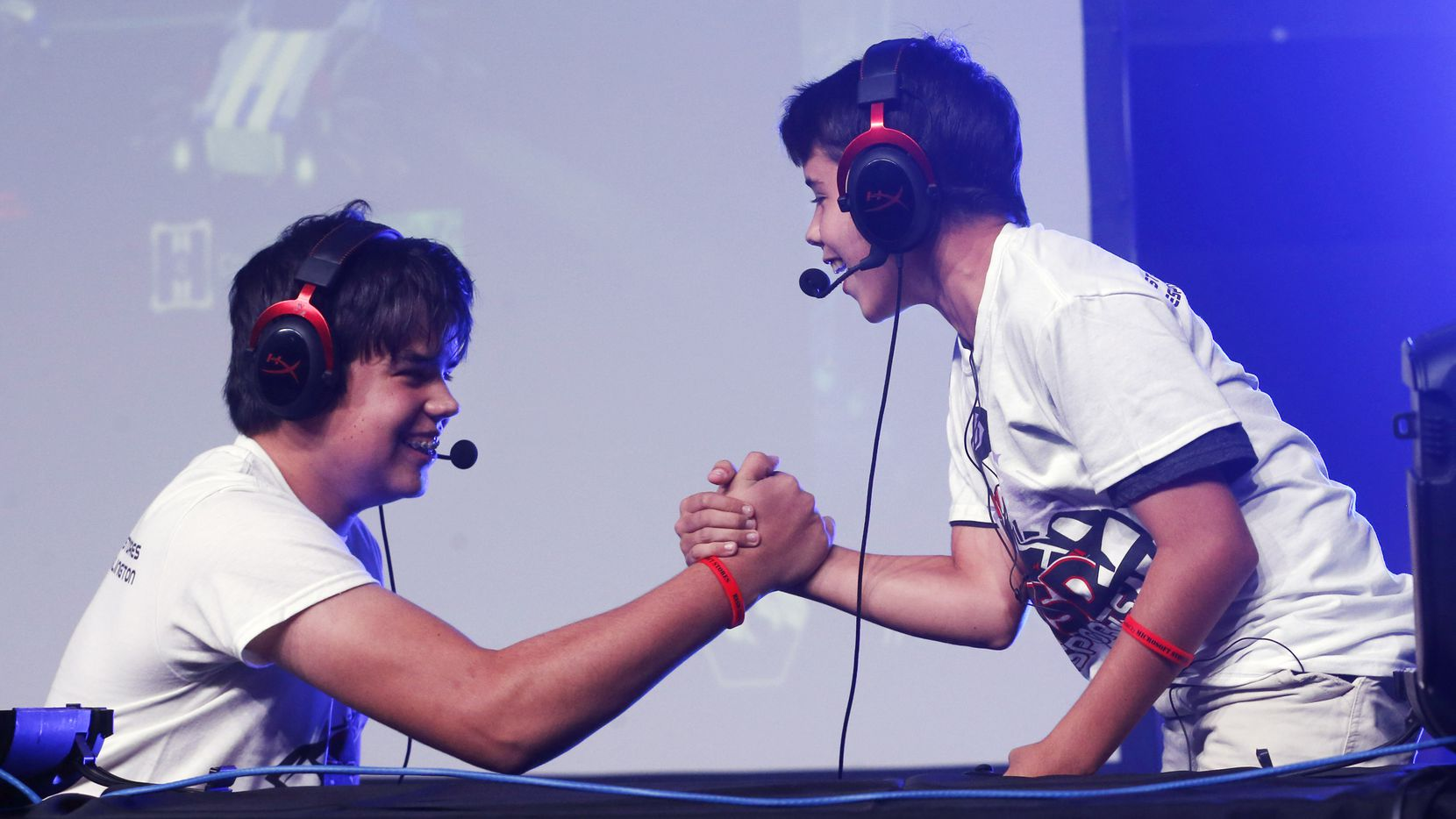 Peyton Clothier, 14 (left) celebrates with his brother Colton Clothier, 12 (right) of Burleson after winning a game of Rocket League during the BISD Esports Fall Invitational at Esports Stadium Arlington, on Saturday, September 7, 2019. Kids in grades K-12 competed in Super Smash Bros. Ultimate, Rocket League, Fortnite Battle Royale, and Minecraft. (Vernon Bryant/The Dallas Morning News)