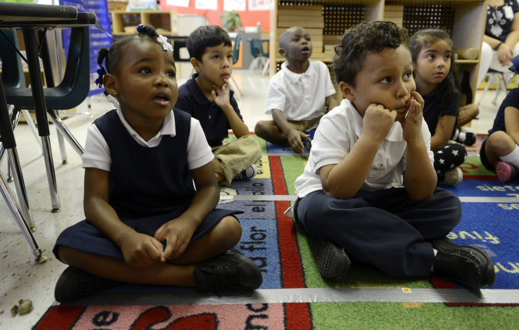 Prekindergartners Za'naae Alley and Edwin Avalos listened to a lesson at Kramer Elementary School in North Dallas in September 2014. A current early education initiative in Dallas ISD is showing promise.