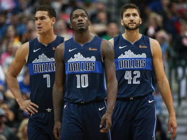 Dallas Mavericks forward Dwight Powell (7), forward Dorian Finney-Smith (10) and forward Maximilian Kleber (42) react to a play during the second half a game between the Dallas Mavericks and the Utah Jazz at the American Airlines Center in Dallas, Sunday, October 28, 2018.