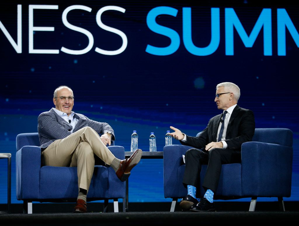 AT&T CEO John Stankey talks on stage wth CNN anchor Anderson Cooper during an AT&T Business Summit in Grapevine.