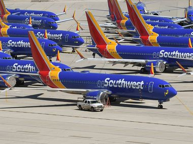 Southwest Airlines Boeing 737 MAX aircraft are parked on the tarmac at the Southern California Logistics Airport in Victorville, Calif.
