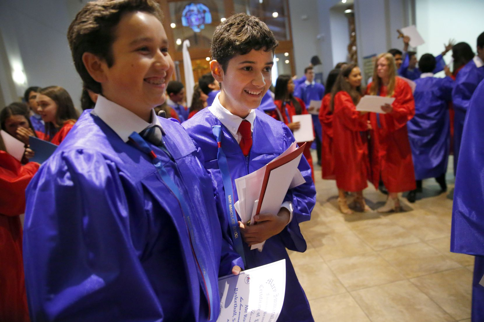 Zach (center) was all smiles as he and his classmates wrapped up their graduation last month at Mary Immaculate Catholic Church in Farmers Branch.