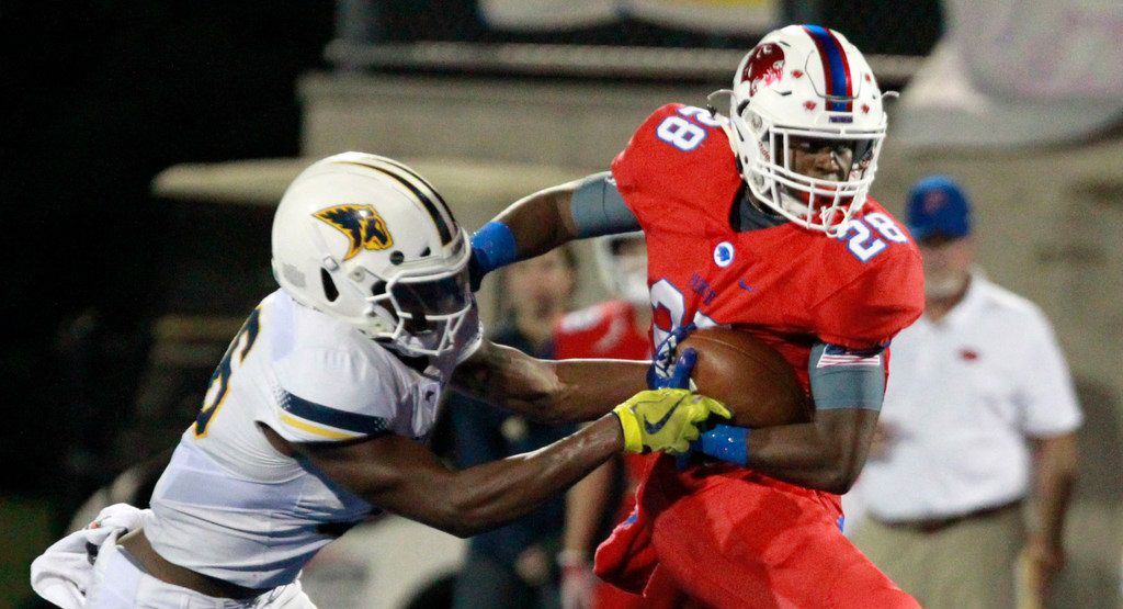 FILE - Prestonwood defender Solomon Turner (36) tries to pick pocket Parish Episcopal Cauren Lynch (28) during the first half of a high school football game at Gloria Snyder Stadium in Dallas on Friday, October 26, 2018. (John F. Rhodes / Special Contributor)