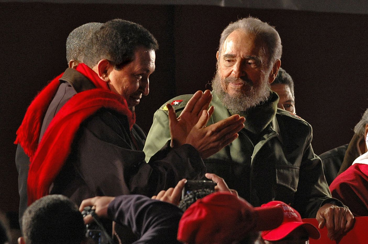 Cuban president Fidel Castro(R) observes his Venezuelan counterpart Hugo Chavez at the end of a rally in Cordoba, Argentina, July 21, 2006.