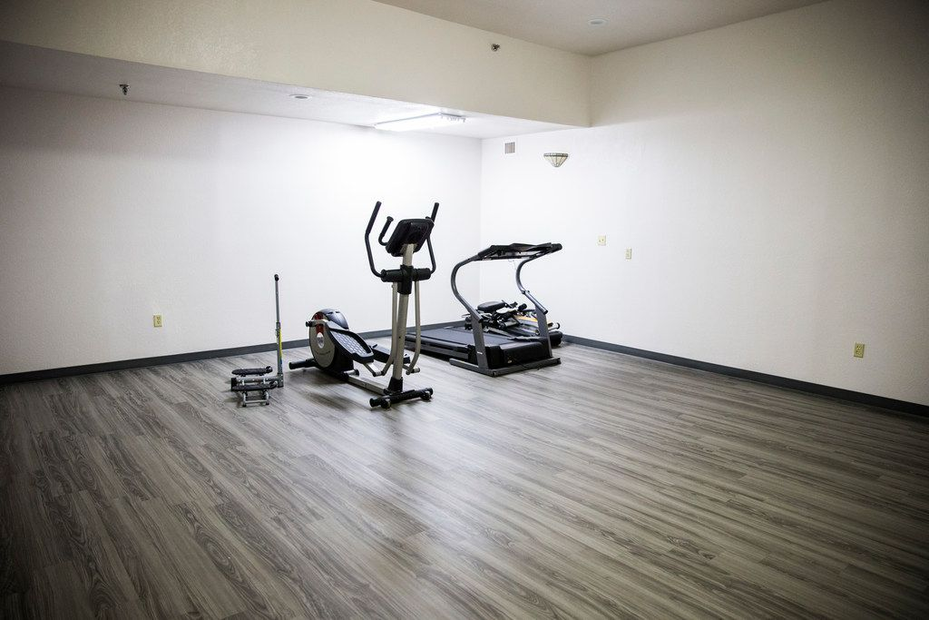 A gym inside St. Jude Center, a senior-living facility for homeless and veterans on Thursday, August 23, 2018. The Dallas Housing Authority was supposed to fill the facility with residents using vouchers, but vouchers are not available due to lack of funding. (Ashley Landis/The Dallas Morning News)