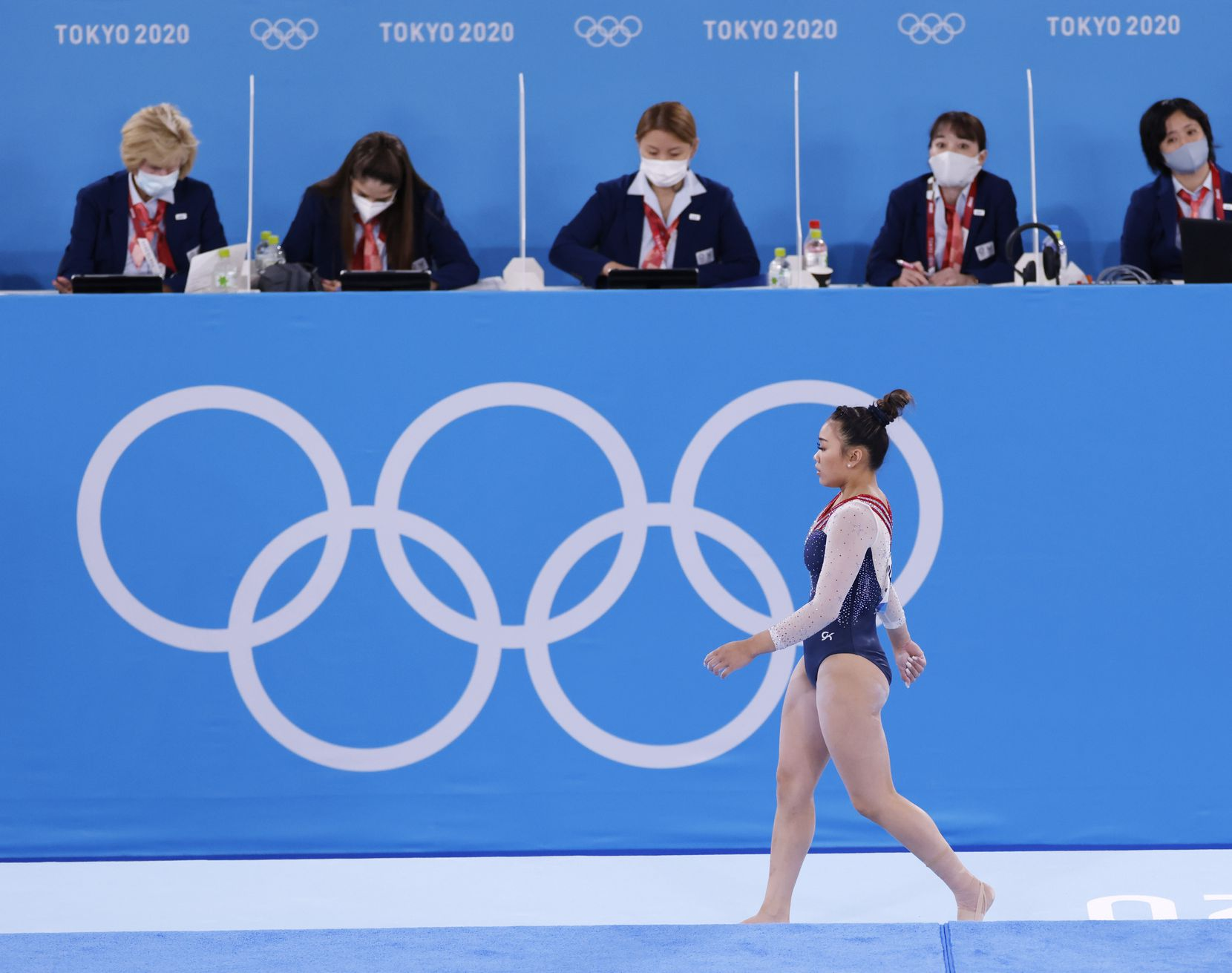 USA's Sunisa Lee makes her way off the floor after completing her routine during the women's all-around final at the postponed 2020 Tokyo Olympics at Ariake Gymnastics Centre, on Thursday, July 29, 2021, in Tokyo, Japan. (Vernon Bryant/The Dallas Morning News)