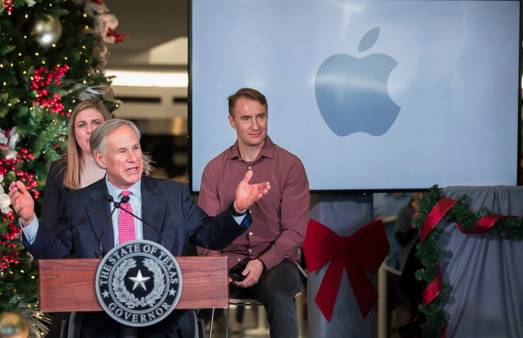 Texas Gov. Greg Abbott speaks about Apple's new campus announcement in Austin, Texas, Thursday, Dec, 13, 2018. Apple plans to build a $1 billion campus in Austin, that will create at least 5,000 jobs ranging from engineers to call-center agents while adding more luster to a Southwestern city that has already become a bustling tech hub. The decision, announced Thursday, comes 11 months after Apple CEO Tim Cook disclosed plans to open a major office outside California on the heels of a massive tax break passed by Congress last year. (Ricardo Brazziell/Austin American-Statesman via AP)