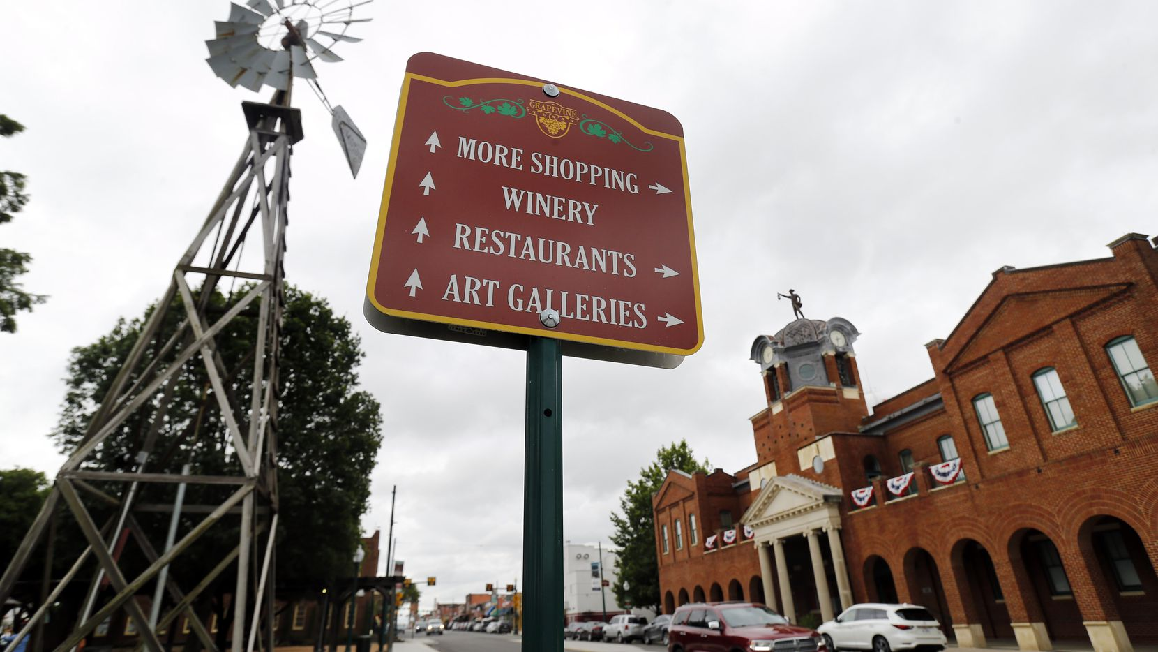 A sign gives directions to tourists visiting historic Grapevine, Texas, Tuesday, June 23, 2020. The marker is in Liberty Park. City Hall is pictured on the right. (Tom Fox/The Dallas Morning News)