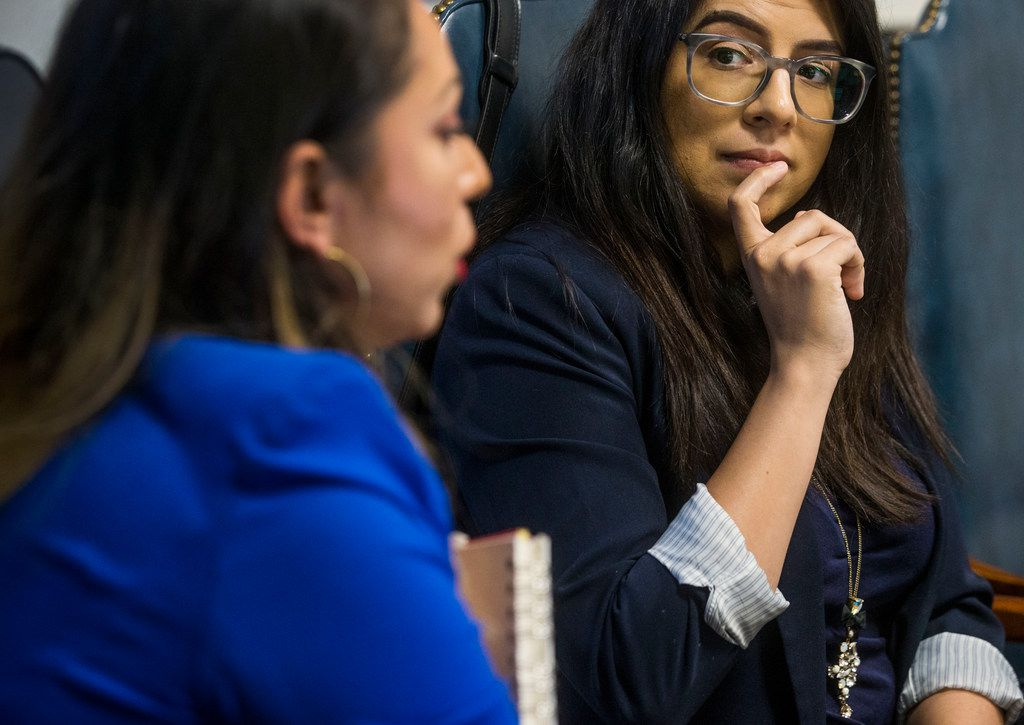 Tristeza Ordex-Ramirez, president at El Voto Es Latino (left), talks while Valerie Ramos, vice president at El Voto Es Latino, watches during an interview at Victoria Neave's campaign headquarters in Dallas on Sept. 2, 2018.