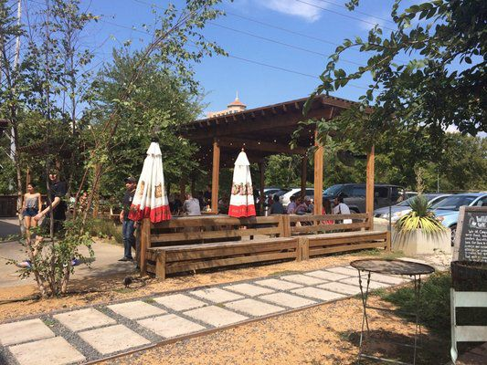 Diners on Company Cafe's patio can watch the runners, walkers and bikers fly by on the Katy Trail.