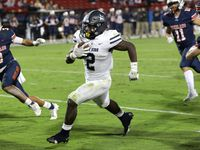 Lone Star player #2, Ashton Jeanty, finds a pocket as he runs for a touchdown during a Frisco Lone Star High School versus Frisco Wakeland High School football game at Toyota Stadium in Frisco, TX, on Oct. 15, 2021.