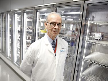 """President and CEO of Carter BloodCare, Dr. Merlyn Sayers, is pictured before an empty cooler at their headquarters in Bedford, Texas, Wednesday March 18, 2020. The Center is putting out the word that they have a shortage of blood. """"Something like 600 people a day in our community need a transfusion. They can't wait 'til coronavirus has blown over."""", he said. This is reflective of a growing nationwide shortage."""