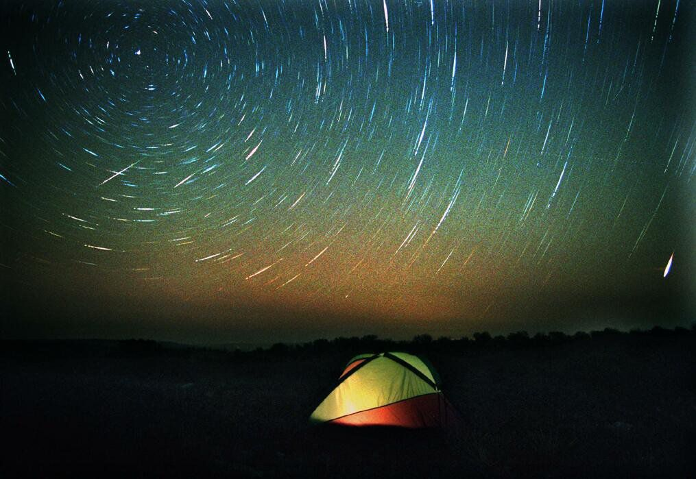 A tent under the Leonid meteor shower over Lambshead Ranch near Albany, north of Abilene. The meteors are the two straight streaks at left and bottom right in this time-lapse photo.
