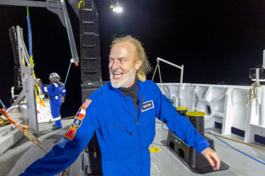 In this photo provided by Atlantic Productions for Discovery Channel, Victor Vescovo emerges from his submersible 'Limiting Factor' after a successful dive to the deepest known point in the Mariana Trench, April 28, 2019. Vescovo, a businessman and amateur pilot, has also traversed the highest peaks of mountains, including Mount Everest.