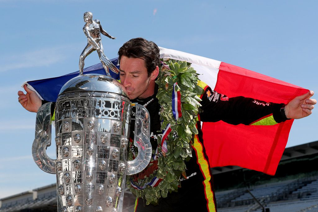 INDIANAPOLIS, INDIANA - MAY 27: Simon Pagenaud of France, driver of the #22 Team Penske Chevrolet kisses Borg-Warner Trophy during the Winner's Portraits session after the 103rd running of the Indianapolis 500 at Indianapolis Motor Speedway on May 27, 2019 in Indianapolis, Indiana. (Photo by Clive Rose/Getty Images) *** BESTPIX ***