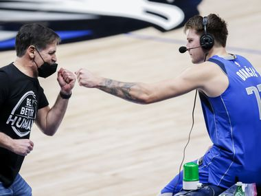 Mavericks owner Mark Cuban fist bumps guard Luka Doncic (77) after a 118-117 win against the Hawks on Wednesday, Feb. 10, 2021, in Dallas.